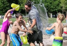 Kids and Father throwing water from buckets