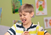 Boy uninterested in eating and drinking fresh fruit juice